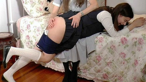 Stevie Bends Over For Her Punishment With The Strap On Her Bare Bottom