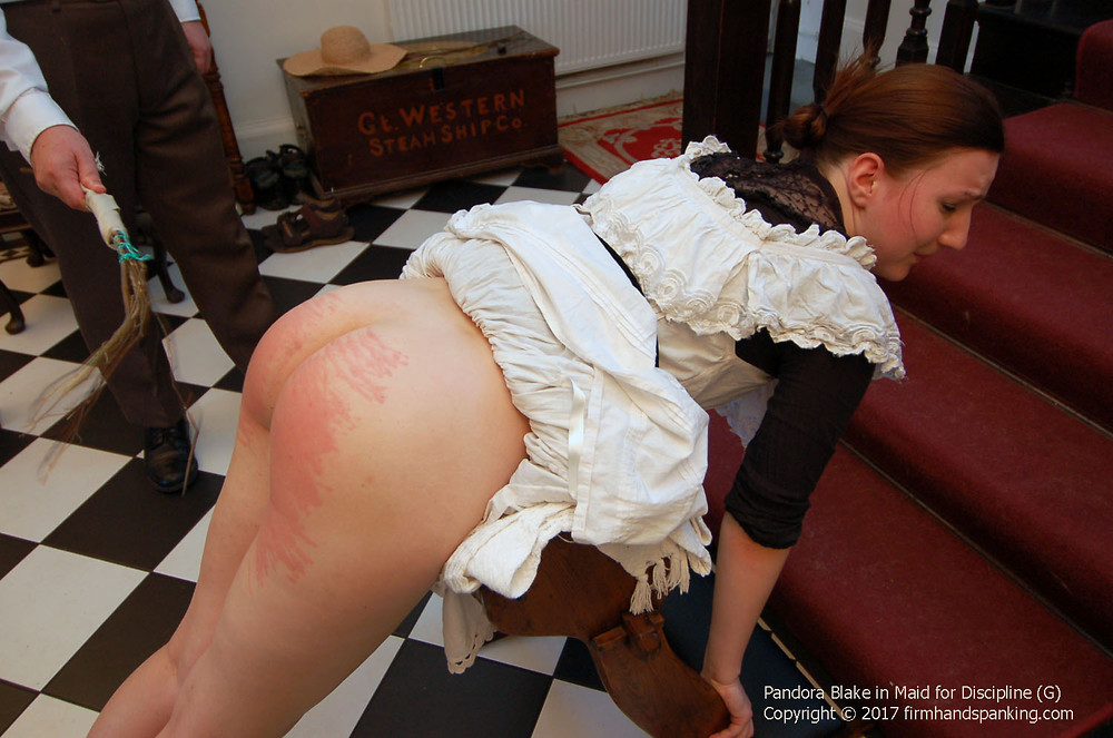 Naughty maid spanked in stockings